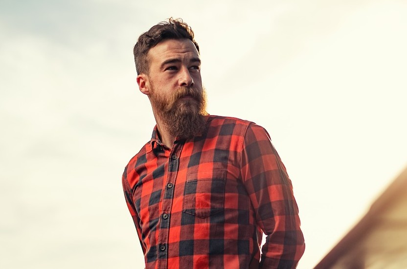 Bearded man with red plaid shirt