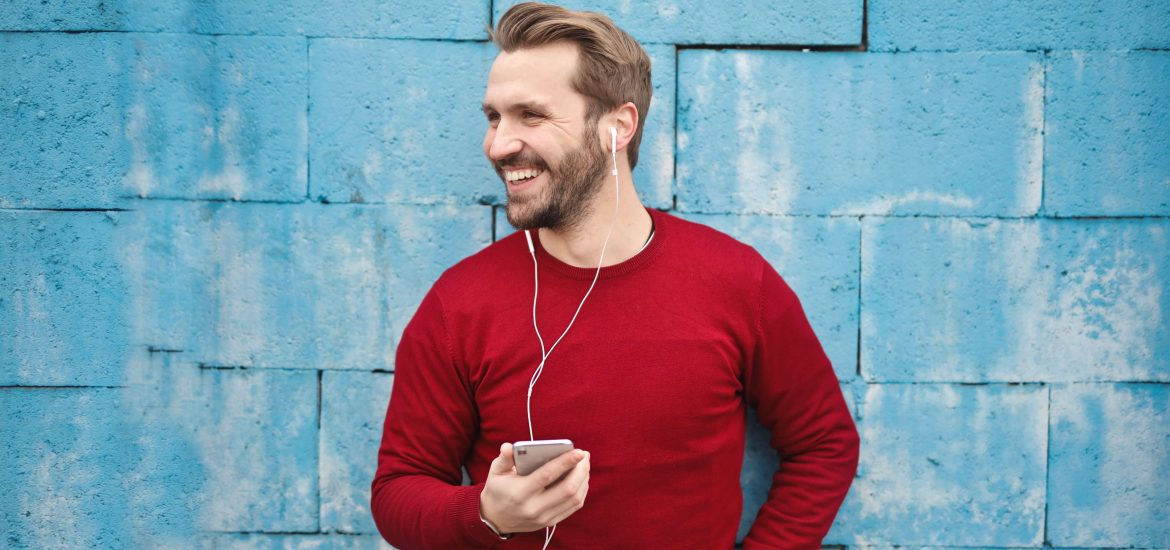 blonde hair man with earphones