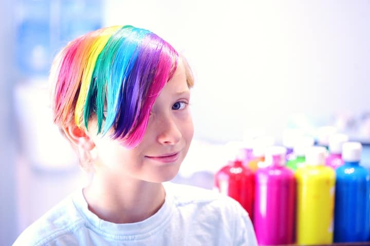 A boy with rainbow hair dye