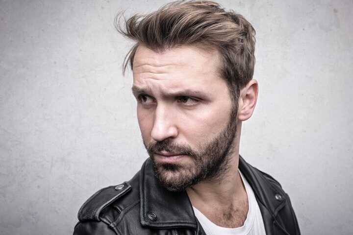 a man with long to short haircut
